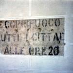 Scritta visibile fino a qualche anno fa in c.so V.Emanuele che ricorda ai cittadini il coprifuoco